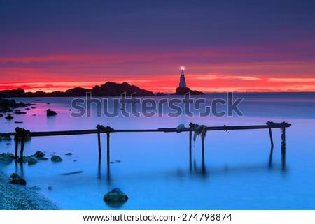 Sunrise at the rocky beach of the Black Sea near Athopol in Bulgaria - stock photo