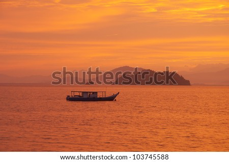 Sunrise at the sea and island background. - stock photo