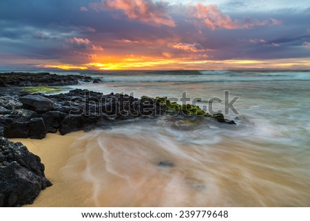 Sunrise at the shore of Sandy Beach on Oahu, Hawaii - stock photo