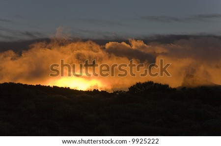 Sunrise at the Teide National Park - illuminated cloudscape - stock photo