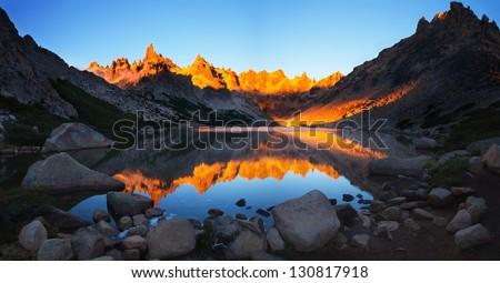 Sunrise at the tourist camp Frey, Tonchek lagoon, Patagonia, Argentina - stock photo