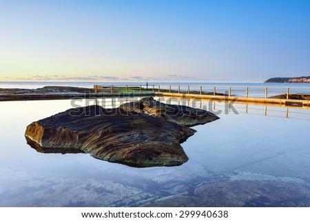 Sunrise at tidal pool in North curl curl. Sydney, Australia - stock photo