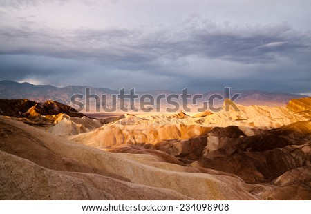Sunrise Badlands Amargosa Mountain Range Death Valley Zabriskie Point - stock photo