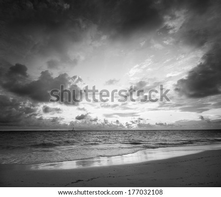 Sunrise Bavaro Beach, Punta Cana, Dominican Republic. Black and white monochrome. Vacation, travel concept - stock photo