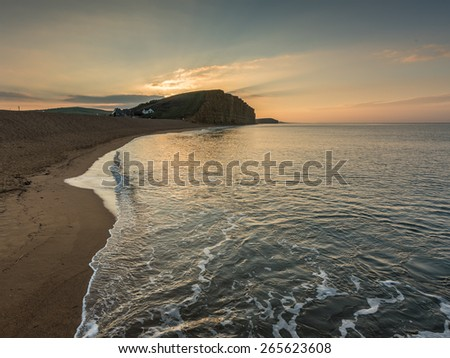 Sunrise beach at West bay in Dorset , England - stock photo