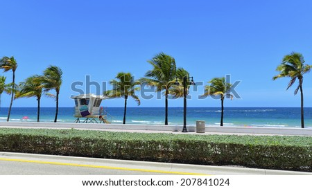 Sunrise Beach in Ft.Lauderdale with palm trees and beach entry feature. - stock photo
