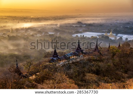 Sunrise behind the mountains at Mandalay hill in Myanmar - stock photo