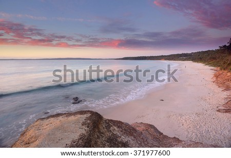 Sunrise colours of dawn looking south over Nelson Beach, Jervis Bay, NSW Australia