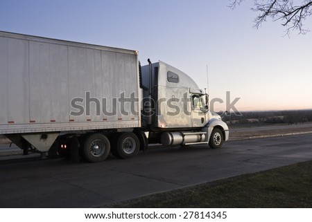Sunrise drive - semi-truck on the road. - stock photo