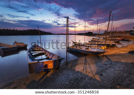 Sunrise Fisherman boat parking at Lumut, Perak.( Visible noise due to high ISO, soft focus, shallow DOF, slight motion blur) - stock photo