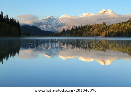 Sunrise foggy mountain reflection, Utah, USA. - stock photo