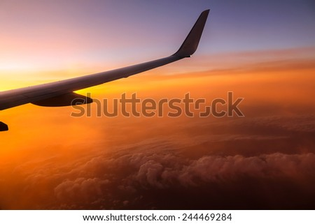 Sunrise from airplane's window over Italy