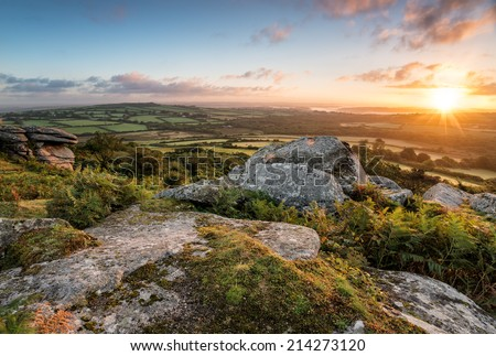 Sunrise from Helman Tor a rugged outcrop of granite and moorland near Bodmin in Cornwall, looking out towards Sweetshouse - stock photo