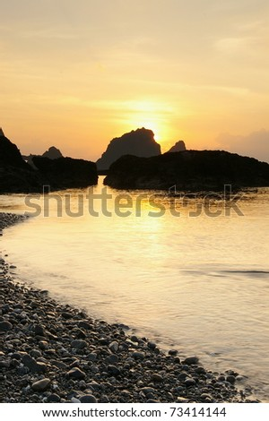 sunrise from the hill and sea - stock photo
