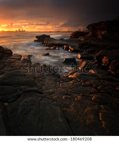 Sunrise glow on Mooloolaba Rocks