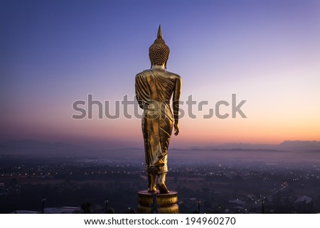 Sunrise, Golden buddha statue in Khao Noi temple, Nan Province, Thailand  - stock photo