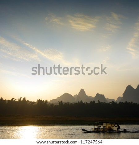 Sunrise Guilin raft landscape - stock photo