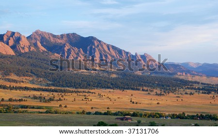 Sunrise hits the Flatirons and Bear Mountain next to Boulder, Colorado - stock photo