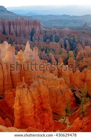 Sunrise Illuminates Orange Rock Formations. Bryce Canyon National Park, Utah - stock photo