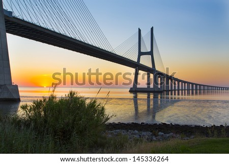 Sunrise in Atlantic - Vasco da Gama bridge (Ponte Vasco de Gama), Lisbon-Portugal - stock photo