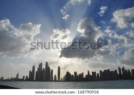Sunrise in DUBAI MARINA - beach side. Dubai, United Arab Emirates is the most busiest place in the Gulf Region- nice a person sees such scene it minimizes the stress they usually have from work.