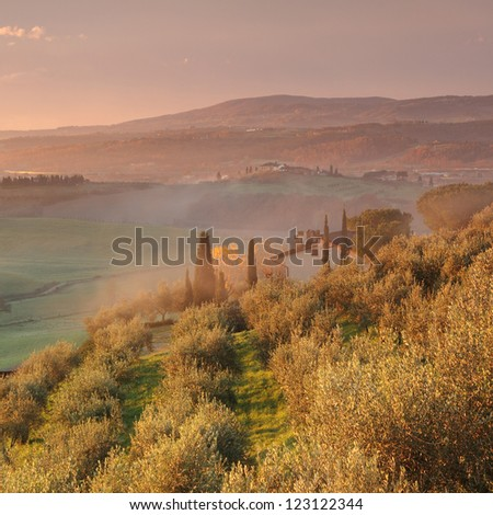 Sunrise in fantastic tuscan landscape with morning mist, Tuscany, Italy, Europe - stock photo