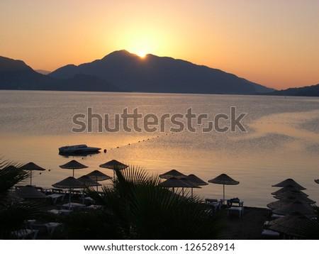 Sunrise in Marmaris, Turkish resort, with mountains - stock photo