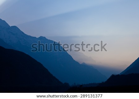 Sunrise in mountains - first sunbeam