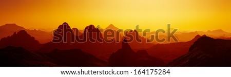 Sunrise in Sahara Desert, Hoggar mountains, Algeria - stock photo