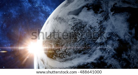 Sunrise in space with prominent sun flare and streaks. Orbital view on a planet covered in clouds from space. Planet is covered in clouds. Elements of this image furnished by NASA. 3d illustration