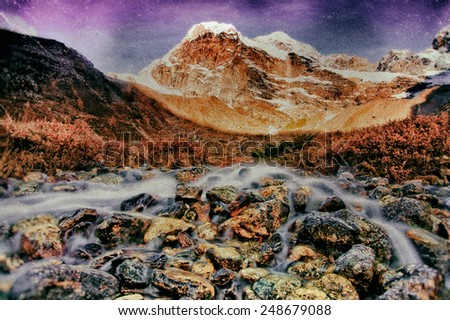 Sunrise in the Himalayas, at a beautiful stream, Everest Region, Nepal - stock photo