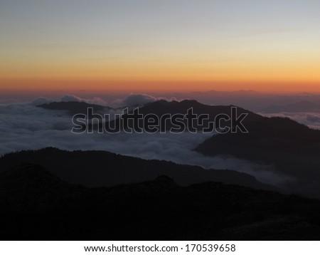Sunrise in the Himalayas, sea of fog - stock photo