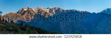 Sunrise in the Himalayas, the first rays of the sun -  view from Auli, India. - stock photo
