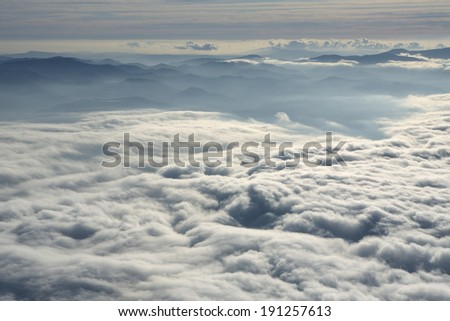 Sunrise in the mountains above the cloud rolling in the valley
