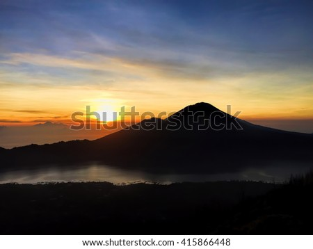 Sunrise in the mountains, Bali nature in the morning, morning sunrise on Batur volcano, mountain Batur trekking, sunrise view to lake and mountain, sunrise in mountains, morning mountain landscape
