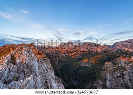 Sunrise in the mountains. Early morning as viewed from the top of Visevnik hill with vast landscape below.