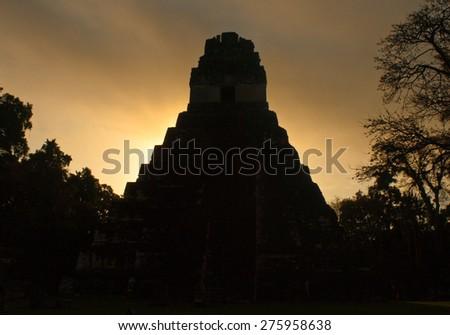 Sunrise in Tikal - stock photo