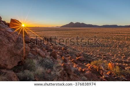 Sunrise in Tiras Mountains in Namibia - stock photo