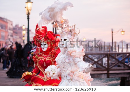 Sunrise in Venice Italy in front of the Grand Canal  Beautiful costumed woman - stock photo