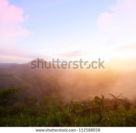 Sunrise in volcano Batur caldera. Bali, Indonesia - stock photo