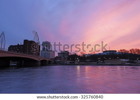 Sunrise in Wichita, Kansas - downtown buidlings accross Arkansas River - stock photo