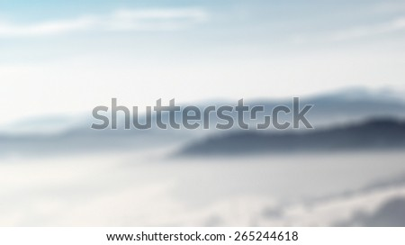 Sunrise in Winter Mountains. Blurred Background. - stock photo