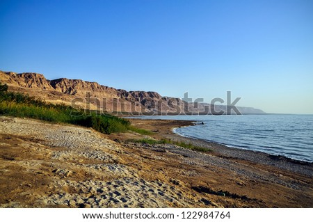Sunrise. Incredible lighting effects on the Dead Sea in Israel. - stock photo