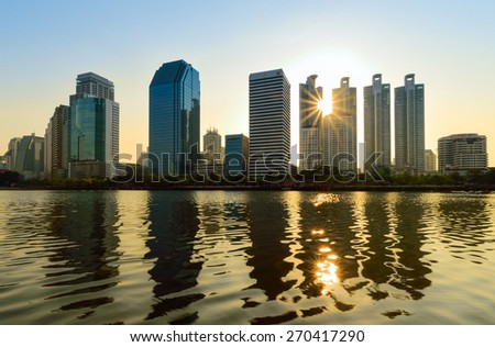 Sunrise Lake at the Benchakitti Park in Bangkok on 14 April 2015. Benjakiti Park is a park in honor of Her Majesty Queen Sirikit, is located in the factory area. - stock photo