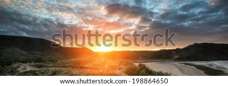 Sunrise landscape panorama Three Cliffs Bay in Wales