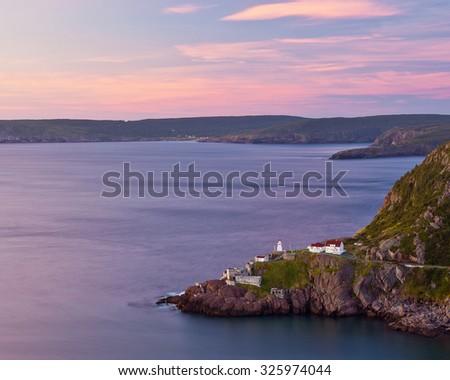 Sunrise looking over Fort Amherst, Newfoundland. - stock photo