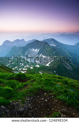 Sunrise mountain panorama from Brienzer Rothorn with purple sky, Switzerland.