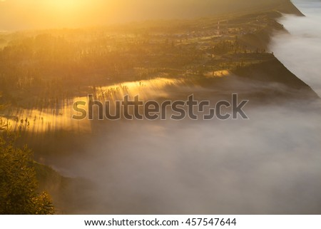 Sunrise Mountains.Asia Nature Morning Volcano Viewpoint.Mountain Trekking,View Landscape Valley Bali Village. Nobody photo. Horizontal picture. The first rays of the rising sun