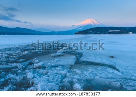 Sunrise of Frozen Lake with Mount Fuji at Yamanaka Lake, after the heavy snow storms in the past 120 years in 20 February 2014