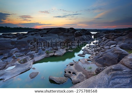 Sunrise of sampanbok (3000 Hole), The Amazing of Rock in Mekong River, Ubon Ratchathani, Thailand - stock photo